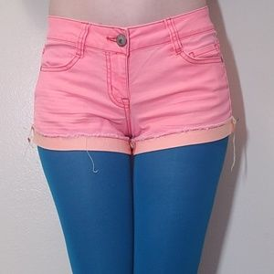 Pink lightly distressed shorts